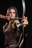 stock photo of longbow  - Young girl has some dangerous hobby - JPG