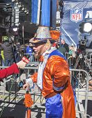 Unidentified Denver Broncos fan during interview with CNN on Broadway during Super Bowl XLVIII week