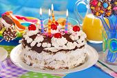 image of tort  - chocolate torte with candles and homemade sweets for children birthday party - JPG