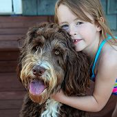 Little Girl with pet dog closeup