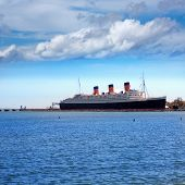 LONG BEACH, CALIFORNIA - April 11, 2013: Queen Mary Ship moored at Long Beach harbor Port California in April 11, 2013. From May 1936 the grandest ocean liner, now a tourist attraction in Long Beach