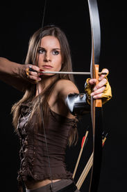 picture of longbow  - Young girl has some dangerous hobby - JPG