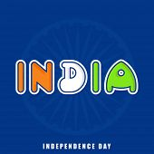 Stylish colorful text India in national flag colors with ashoka wheel on blue background for Indepen