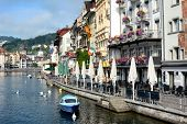 LUCERN, SWITZERLAND - JULY 2, 2014: Hotels and Restaurants on the River Reuss, Switzerland. The rive