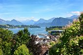 LUCERN, SWITZERLAND - JULY 3, 2014: Overview of Lucern City, the lake and Alps. From the Musegg Wall