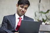 An Indian businessman using tablet PC