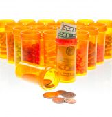 The High Cost Of Health Care.  Pills, Us Currency And Coins In Pill Bottles Isolated On White.