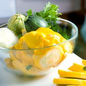 fresh zucchini and squash in a glass bowl
