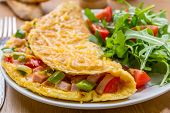 stock photo of rocket salad  - Delicious Egg Omelet with Ham and Vegetables on the Plate - JPG