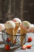 Ice creams in a basket with fruit