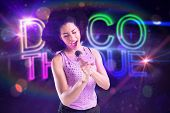 Pretty girl singing against digitally generated colourful discotheque text