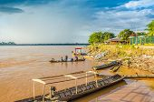 RURRENABAQUE, BOLIVIA, MAY 10, 2014 - Traditional wooden boats moor on Beni river bank