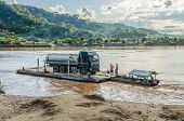 RURRENABAQUE, BOLIVIA, MAY 10, 2014 - ferry on Beni river transports a lorry from San Buenaventura on other riverbank