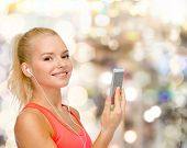 sport, fitness, technology, internet and healthcare - smiling sporty woman with smartphone and earph