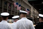 NEW YORK - MAY 23: A group of US Navy officers on liberty wait to cross Broadway in midtown Manhatta