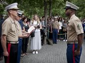 NEW YORK - MAY 23, 2014: U.S. Marine Brandon King stands facing Marine Lt. General William Faulkner before taking the Oath to re-enlist during the ceremony at the National September 11 Memorial site.