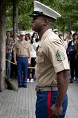 NEW YORK - MAY 23, 2014: U.S. Marine Brandon King stands at attention during the re-enlistment and p