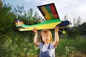 children with airplane toy outdoors