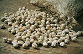 foto of bengal-gram  - a pile of dried chickpeas on a rustic wooden table - JPG