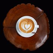 Cup of latte coffee on wooden