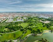 Aerial view of Olympiapark and Munich from Olympiaturm (Olympic Tower) with tilt shift toy effect sh