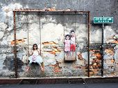 Children On The Swing Street Art Piece In Georgetown, Penang, Malaysia