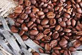 Coffee beans on wicker mat background