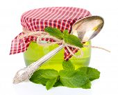 Homemade mint jelly in glass jar, isolated on white
