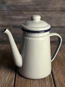 Grey teapot on wooden background