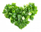 Heart shape of chopped green onion, isolated on white
