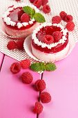 Delicious berry cakes on table close-up