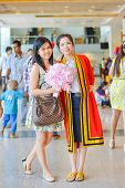 Graduate Thai college student from King Mongkut's institution standing with her friend