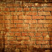 Red Brick Wall Background With Black And Red Stains