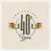 Vintage Anniversary type emblem with golden ribbon and decorative elements - vector illustration