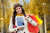 Woman Showing Digital Tablet After Shopping