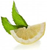 Fresh lemon with mint leaves isolated on white background