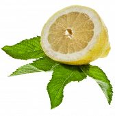 Half lemon with fresh mint leaves isolated on white background