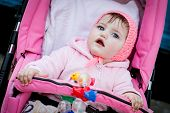 Surprised Baby Girl In Stroller