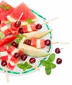 Top View Of Fresh Fruits Salad Of Melon, Watermelon And Cherries  Decorated With Mint