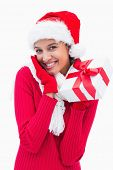 Beautiful festive woman holding gift on white background