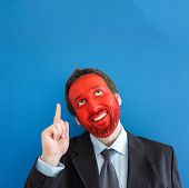 Portrait of adult man with red painted face