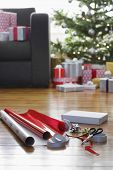 Wrapping paper and accessories for Christmas on hardwood floor