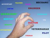 stock photo of cpa  - Photo of a hand in the sky with career titles - JPG