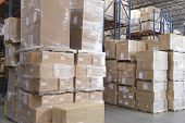 Cardboard boxes stacked in distribution warehouse