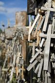 Wooden crosses hanging on tombstone at Lithuanian graveyard