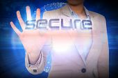 Businesswoman presenting the word secure against futuristic shiny 3d ball