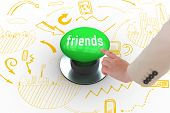 The word friends and businesswoman pointing against digitally generated green push button