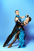Beautiful professional dancers perform tango dance with passion and expression.