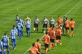 MOSCOW, RUSSIA - JULY 21, 2014: Teams come out on the field before the match OFK, Serbia - Malaga, S