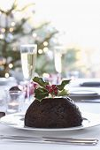 Closeup of Christmas pudding with holly on top